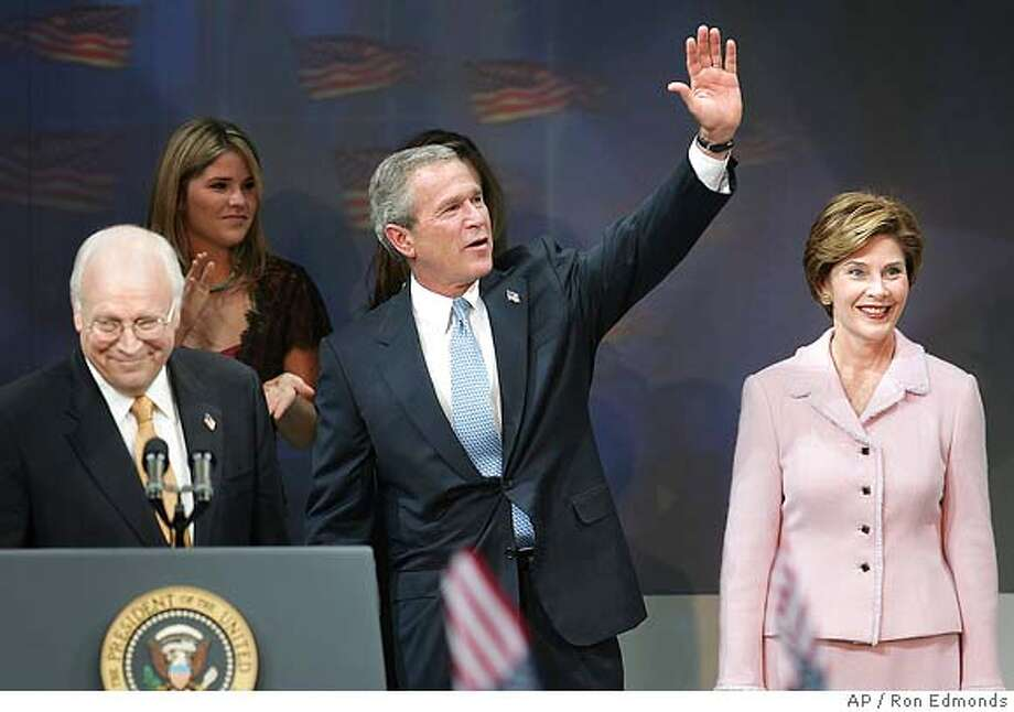 President Bush waves as he comes onto stage as first lady Laura Bush and Vice President Dick Cheney join them on stage at a victory rally Wednesday, Nov. 3, 2004, at the Ronald Reagan Building and International Trade Center in Washington. (AP Photo/Ron Edmonds) Photo: RON EDMONDS
