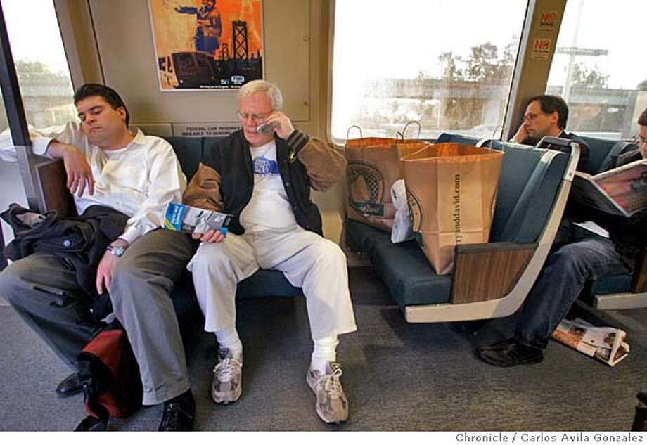 BART28_001_CAG.JPG  Bill Cotton, center, of Concord, Ca., rides the BART train home from a day of shopping in San Francisco, Ca., on Wednesday, April 27, 2005. Cotton, 71, rides BART regularly rather than taking his car, which he says makes him happier than trying to find parking, and dealing with the expense of driving. He is a season Oakland A's ticket holder, and says he never takes anything other than public transportation to the games. He says that BART's proposed changes to the senior fares will really hurt him.  Photo by Carlos Avila Gonzalez/The San Francisco Chronicle  Photo taken on 04/27/05, in Oakland, Ca. Photo: Carlos Avila Gonzalez