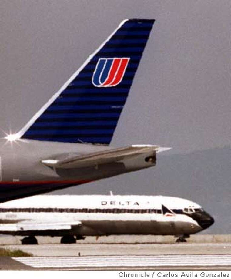 AIRLINES/C/30APR98/BU/CG --- United and Delta Airlines planes, distorted by jetwash, taxi to the runway at San Francisco International Airport after the two companies announced a joint business venture on Thursday, April 30, 1998. (CHRONICLE PHOTO BY CARLOS AVILA GONZALEZ) CAT Business#Business#Chronicle#11/3/2004#ALL#5star##421974141 Photo: CARLOS AVILA GONZALEZ