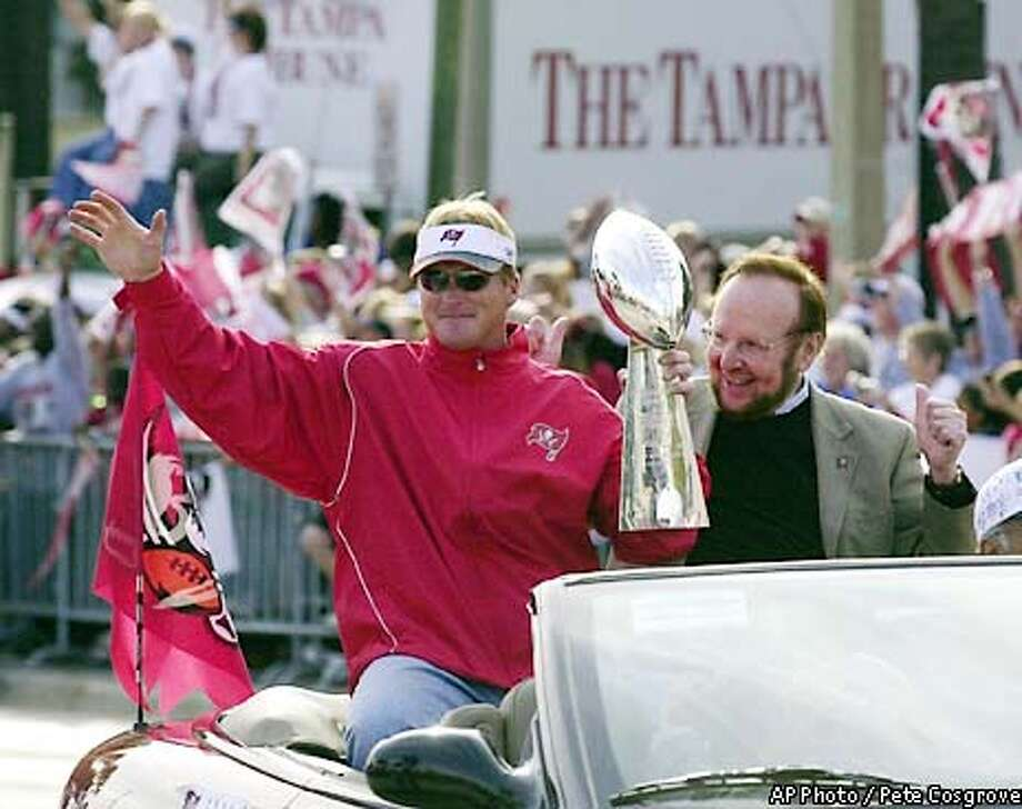 Tampa Bay Buccaneers coach Jon Gruden, left, and owner Malcolm Glazer hold the Vince Lombardi Trophy as they wave to fans along the parade route during a victory celebration Tuesday afternoon, Jan. 28, 2003, in downtown Tampa, Fla. The Buccaneers defeated the Oakland Raiders 48-21 in Super Bowl XXXVII. (AP Photo / Pete Cosgrove) Photo: PETE COSGROVE