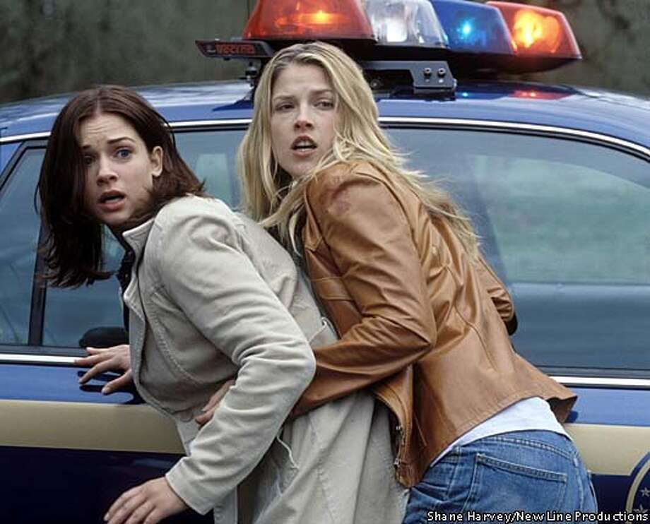 "A.J. Cook, left, and Ali Larter star in the gory action thriller ""Final Destination 2."" New Line Productions publicity photo by Shane Harvey"