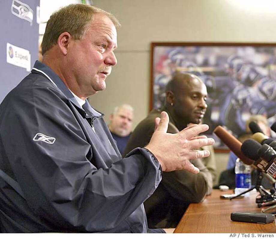 Seattle Seahawks head coach Mike Holmgren, left, talks to reporters about new Seahawks' wide receiver Jerry Rice, right, Tuesday, Oct. 19, 2004 at Seahawks headquarters in Kirkland, Wash. The Seahawks acquired Rice Tuesday from the Oakland Rainders. (AP Photo/Ted S. Warren) Sports#Sports#Chronicle#11/3/2004#ALL#5star##0422421812 Photo: TED S. WARREN