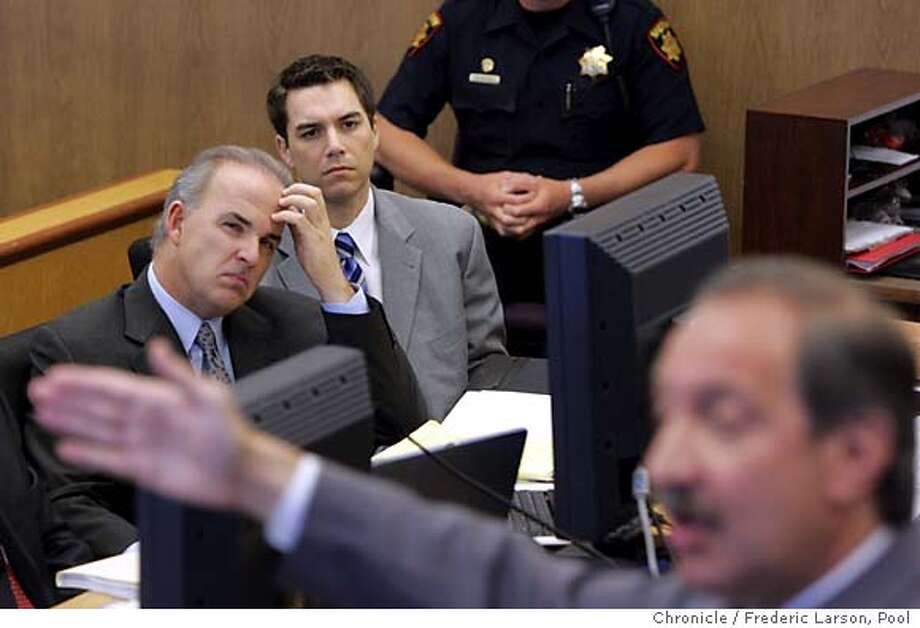 Scott Peterson, center, and attorney Pat Harris, left, listen to attorney Mark Geragos, foreground, during defense closing arguments in Redwood City, Calif., Tuesday, Nov. 2, 2004. (AP Photo/Fred Larson, Pool) Photo: FRED LARSON