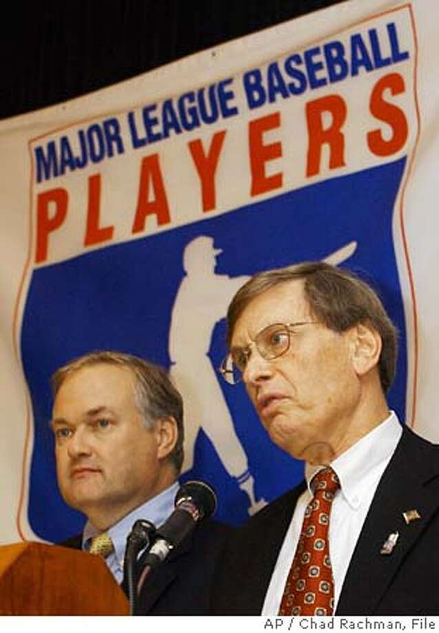 ** FILE ** Baseball Commissioner Bud Selig, right, and Donald Fehr, Executive Director of the Baseball Players Association, address the media in this Aug. 30, 2002 photo in New York. Baseball commissioner Bud Selig asked players to agree to a 50-game ban for first-time steroid offenders and a lifetime ban for a third offense. In a letter sent this week to union head Donald Fehr, Selig proposed a 100-game ban for a second offense. AP Photo/Chad Rachman) A AUG. 30, 2002 FILE PHOTO Photo: CHAD RACHMAN