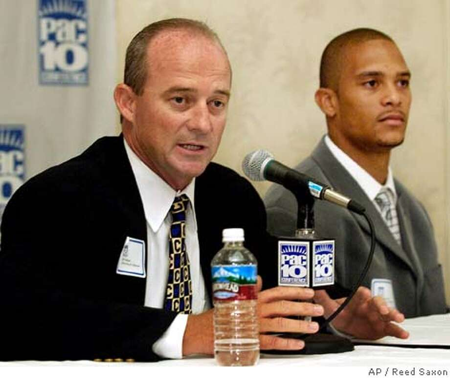 California-Berkeley football coach Jeff Tedford, left, and wide receiver Geoff McArthur talk to reporters at the Pacific 10 Conference football media day Wednesday, July 28, 2004, in Los Angeles. (AP Photo/Reed Saxon) Ran on: 07-29-2004  Cal coach Jeff Tedford looks to build off an 8-6 season. The year was highlighted by wins over USC and Virginia Tech. Ran on: 07-29-2004  Cal coach Jeff Tedford looks to build off an 8-6 season. The year was highlighted by wins over USC and Virginia Tech. Ran on: 07-29-2004 Sports#Sports#Chronicle#11/6/2004#ALL#5star##0422221353 Photo: REED SAXON