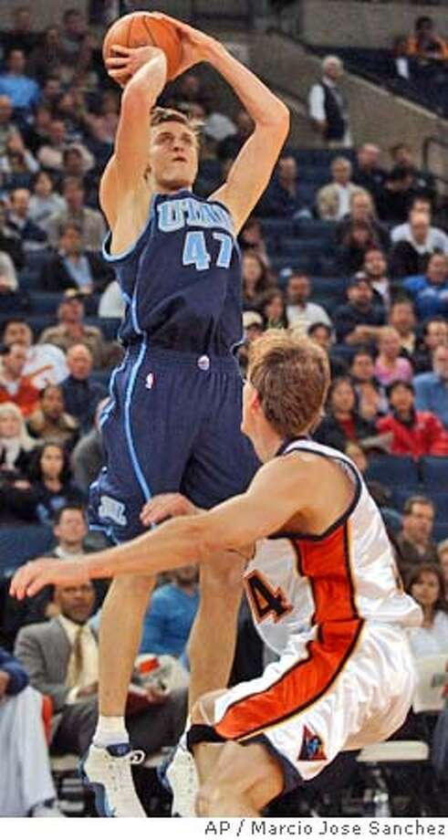 Utah Jazz's Andrei Kirilenko (47) of Russia shoots over Golden State Warriors' Mike Dunleavy during the first half Friday, Nov. 5, 2004, in Oakland, Calif. (AP Photo/Marcio Jose Sanchez) Photo: MARCIO JOSE SANCHEZ
