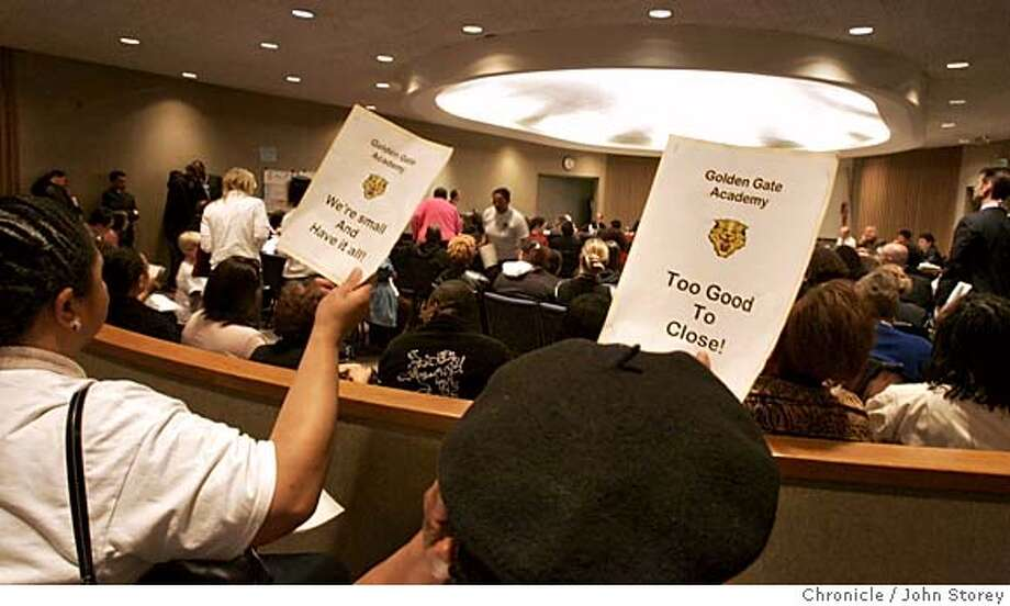 Parents of the Golden Gate School put up signs for their school during the meeting. The San Francisco School Board meets to decide to close schools in San Francisco.  John Storey San Francisco Event on 4/26/05 Photo: John Storey