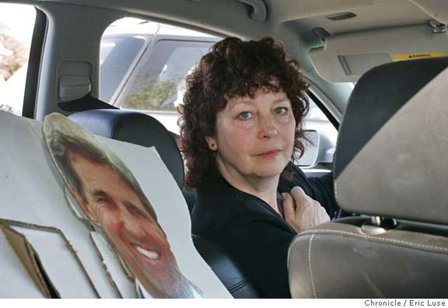 Pat Kunstenaar, Woodacre, hasn't been able to take this Kerry life size card photo of Sen. Kerry since the election. She is taking her granddaughters shopping at the mall. Amanda,13 and her sister Ashley,11 are in the back seat.  Event on 11/6/04 in San Rafael. Eric Luse / The Chronicle Photo: Eric Luse