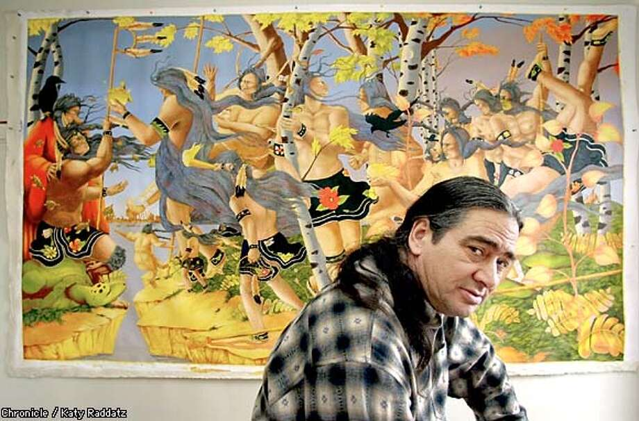 "Rabbett Strickland with ""Dreamer's Rock,"" which depicts a dream of Nanabozho, a rabbit-eared trickster of Ojibwe legend who appears in all of Strickland's paintings. Chronicle photo by Katy Raddatz"