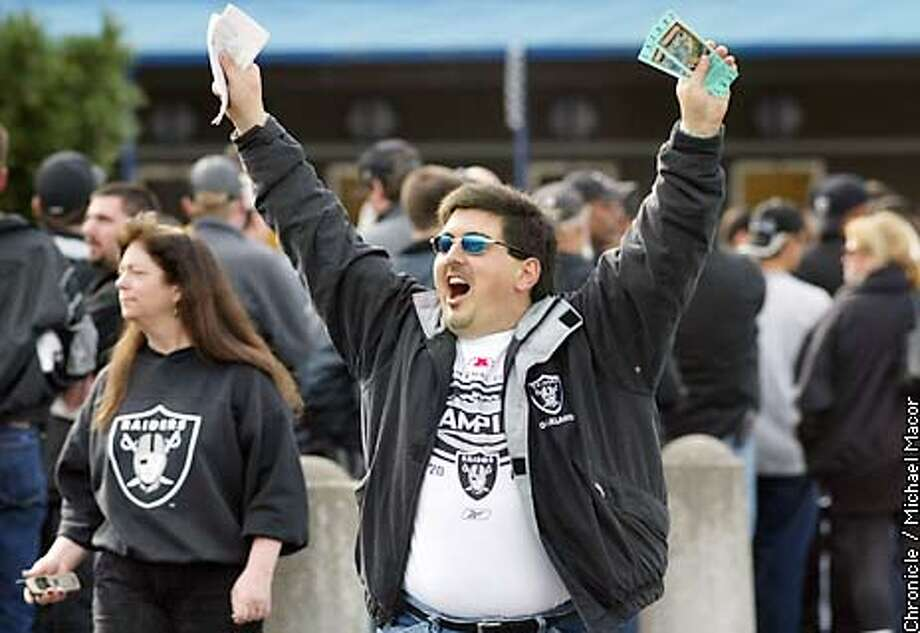 Raider fan Jim Koutsoubinas of Concord shows off his two tickets he just purchased. He had his car packed for the weekend as was leaving for San Diego this afternoon. PSL, Personal Seat License Holders for Raiders season tickets, lined up for the last remaining Superbowl tickets. by Michael Macor/The Chronicle Photo: MICHAEL MACOR