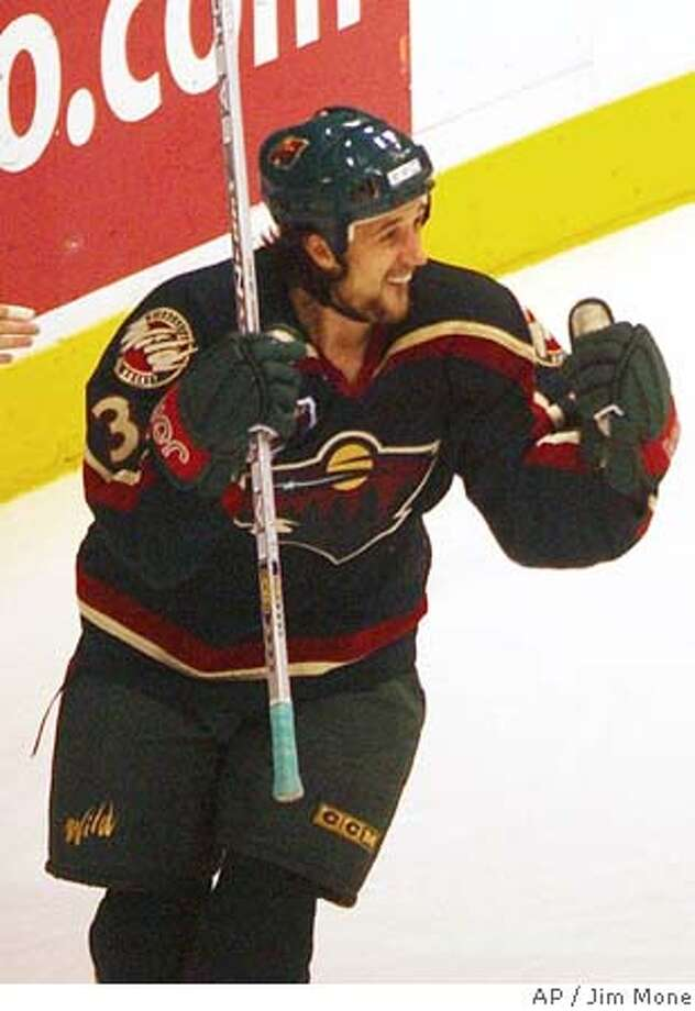 ** FILE ** Minnesota Wild's Sergei Zholtok of Latvia celebrates his game-winning goal as the Wild beat the Vancouver Canucks 1-0, Nov. 11, 2003, in St. Paul, Minn. Zholtok died Wednesday, Nov. 3, 2004 in his native Latvia of an apparent heart ailment. He was 31. (AP Photo/Jim Mone,FILE) NOV. 11, 2003 FILE PHOTO Sports#Sports#Chronicle#11/6/2004#ALL#5star##0422451292 Photo: JIM MONE