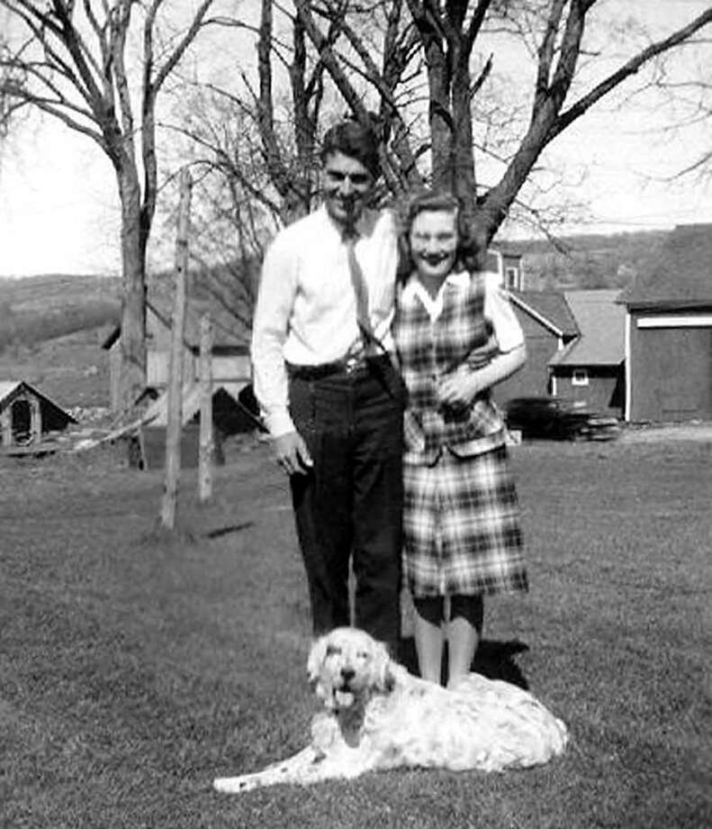 SPECTRUM/Jake and Beth Sullivan pose with their dog for a photo during the years on the farm before they started their family in the 1940s.  Courtesy of the Sullivan family Photo: Contributed Photo
