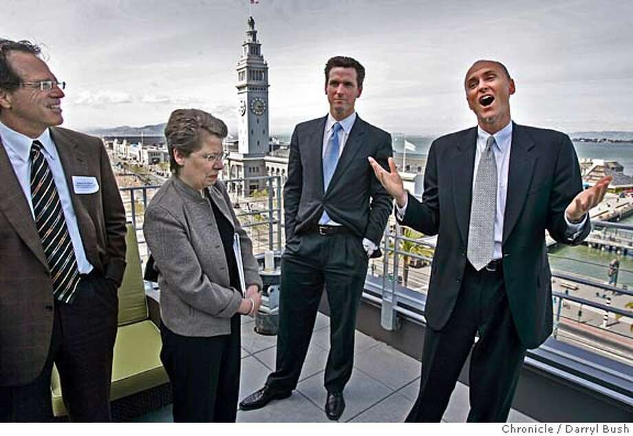 From left: ICOC chair Robert Klein, Dr. Claire Pomeroy, Mayor Gavin Newsom, listen to Chip Conley, CEO of Joie de Vivre Hospitality, right, as he speaks atop the Hotel Vitale with a view of the Ferry Building in the background, offering free hotel rooms to entice decision makers on the tour. San Francisco gives a tour to important people who decide on what city will be chosen as the site for the California Institute for Regenerative Medicine This if for stem cell research.  Event on 4/29/05 in San Francisco.  Darryl Bush / The Chronicle Photo: Darryl Bush