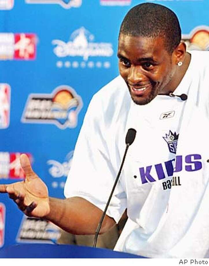 Basketball player Chris Webber of the Sacramento Kings speaks to school children in Beijing on Saturday, Oct. 16, 2004. The NBA is supporting a Read to Achieve program aimed encouraging children to read. The Kings meet the Houston Rockets on Sunday for the NBA's second exhibition game in China. (AP Photo/STR) Sports#Sports#Chronicle#11/2/2004#ALL#5star##0422416131