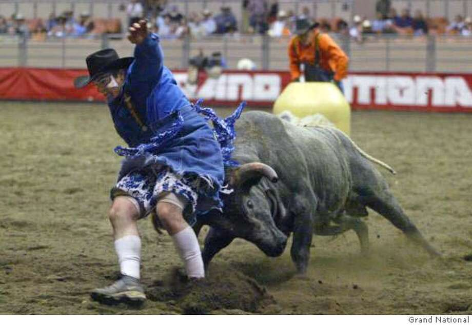 Wild rodeo action with bull fighter Tim O'Conner at the 60th Anniversary Grand National Rodeo, Horse and Stock Show which runs through Sunday, November 7 at the Cow Palace in San Francisco.  Photo credit: Grand National photo Photo: Grand National Photo