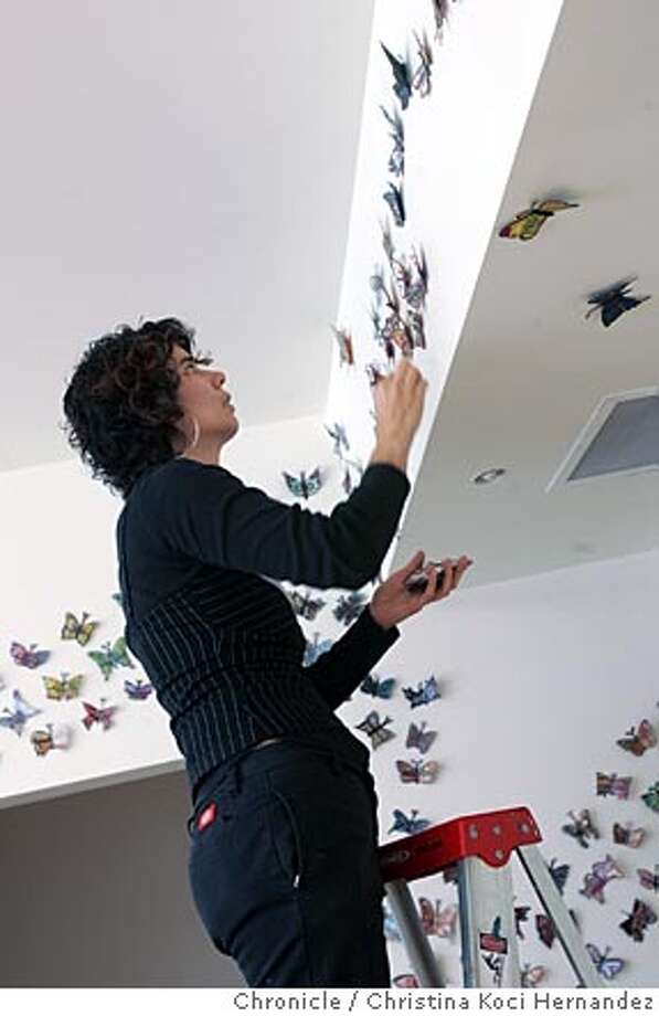 Oakland artist Nancy Mizuno Elliott installs her public art project Pura Vida, in which 1,000 handmade butterflies -- each one different -- will be displayed in an Oakland recreation center for one month. At the end of the project (April 30), the butterflies will be given away with a requested $1 donation, proceeds to benefit the rec center.  City: SF, CA .CHRISTINA KOCI HERNANDEZ/CHRONICLE Photo: CHRISTINA KOCI HERNANDEZ