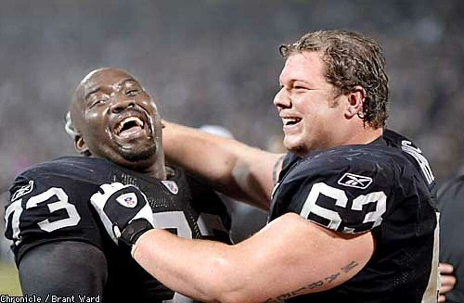 73 Frank Middleton and Barret Robbins celebrated a Raiders victory in the AFC chamnpionship game. By Brant Ward/Chronicle