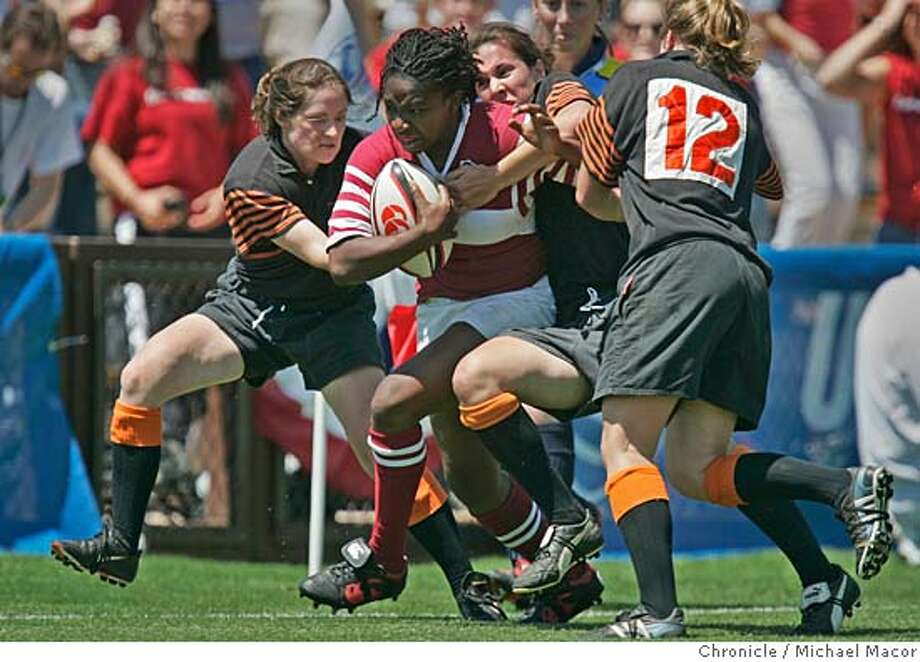 rugbyfinalfour_109_mac.jpg Stanford's 14- Victoria Forlayan drags a group of Princeton women deep into enemy territory. Princeton players l to r- are Casey Gallagher, Ruth Bryson and Dasha Zamolodchikov. Stanford women's rugby face off against Princeton in a national semi-final match. Stanford pulled out a victory to advance 27-22. 4/29/05 Palo Alto, Ca Michael Macor / San Francisco Chronicle Mandatory Credit for Photographer and San Francisco Chronicle/ - Magazine Out Photo: Michael Macor