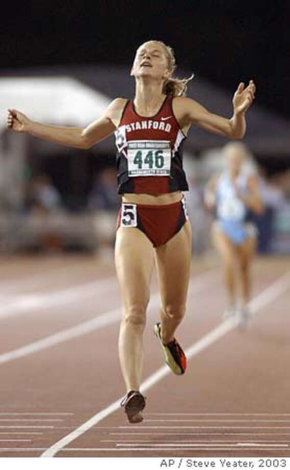 Stanford's Lauren Fleshman crosses the finish line to win the women's 5,000 meters with a time 15:24.06 during the NCAA track and field championships in Sacramento, Calif., Saturday, June 14, 2003. (AP Photo/Steve Yeater) CAT Photo: STEVE YEATER