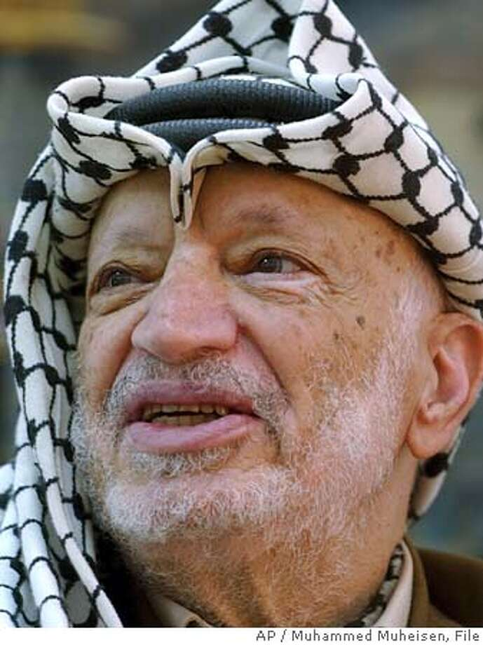 ** FILE ** Palestinian leader Yasser Arafat is shown during a meeting at his headquarters in the West Bank town of Ramallah on Sept. 26, 2004. Arafat, fighting for his life in a French hospital, has lost consciousness repeatedly, Palestinian officials said Thursday, Nov. 4, 2004. They described his condition as extremely serious. (AP Photo/Muhammed Muheisen, File) SEPT. 26, 2004 FILE PHOTO Nation#MainNews#Chronicle#11/5/2004#ALL#5star##0422450730 Nation#MainNews#Chronicle#11/5/2004#ALL#5star##0422450730 Photo: MUHAMMED MUHEISEN