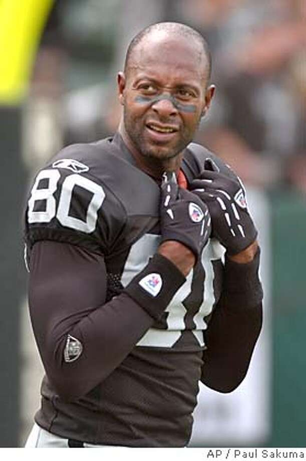 ** FILE ** Oakland Raiders wide receiver Jerry Rice watches the game from the sidelines during the Raiders 31-3 loss to the Denver Broncos, in this Oct. 17, 2004 photo, in Oakland, Calif. Rice probably should have retired after last season or perhaps earlier. Instead, he finds himself in Seattle, at 42 a very ordinary receiver whose superstar days are far behind him. Yes, it's tough for superstars to retire, even when they should. (AP Photo/Paul Sakuma) ** ADVANCE FOR WEEKEND EDTIONS OCT. 23-24 ** A OCT 17, 2004 FILE PHOTO Sports#Sports#Chronicle#11/4/2004#ALL#5star##0422425037 Photo: PAUL SAKUMA