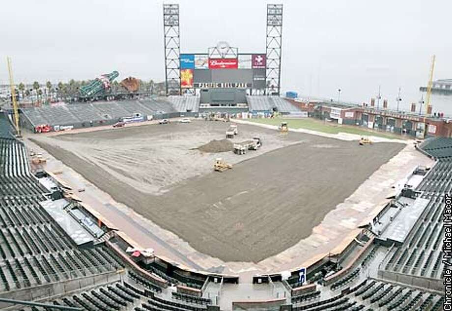 Pacific Bell Park in SF being transformed into a Supercross track for this weekends race. Motocycles will soon be racing around the baseball diamond, as tons of dirt is brought in. It will take 400 truck loads to make up the track. by Michael Macor/The Chronicle Photo: MICHAEL MACOR