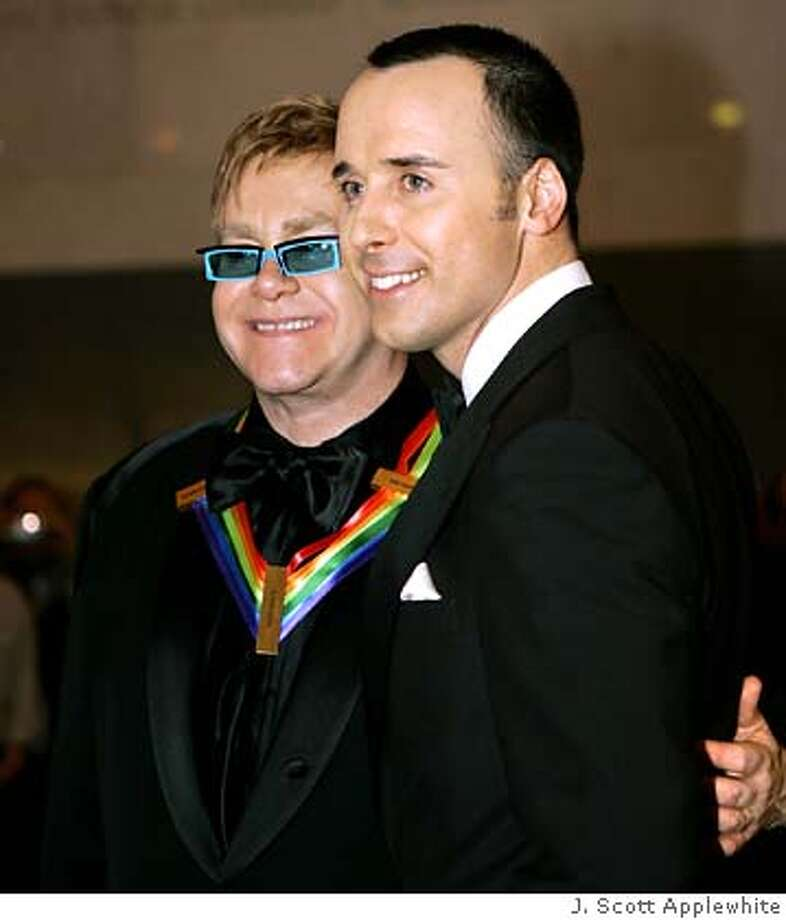 **FILE**Pop singer and composer Elton John, left, arrives with David Furnish, to be feted at the Kennedy Center Honors gala at the John F. Kennedy Center for the Performing Arts in Washington, on Dec. 5, 2004. John will marry his Furnish, his longtime partner, later this year or early next year, his publicist said, Monday, April 25, 2005.(AP Photo/J. Scott Applewhite) Photo: J. SCOTT APPLEWHITE