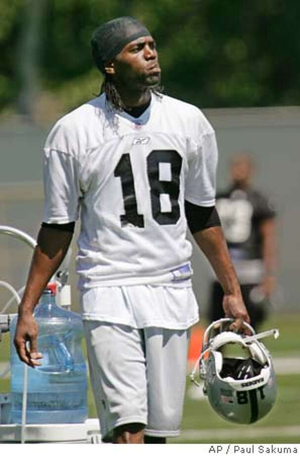 Newly acquired Oakland Raiders wide receiver Randy Moss takes a water break during the first minicamp at Raiders headquarters in Alameda, Calif., Friday, April 29, 2005. Moss was acquired last month in a trade with the Minnesota Vikings. (AP Photo/Paul Sakuma) Photo: PAUL SAKUMA