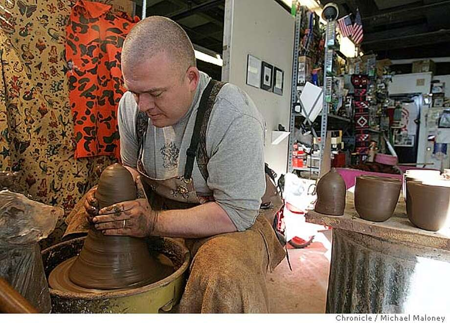 Ehren Tool works in his UC Berkeley campus studio.  Ehren Tool is a Gulf War vet who went with a gung-ho warrior attitude but was highly disturbed by what he experienced. After the war he became a ceramic artist, making thousands of clay cups with war images embedded in them. It's an attempt by the artist to communicate the reality of war without taking a political stand for or against it. Tool, a UCB art major works at a Berkeley campus studio.  Photo by Michael Maloney / San Francisco Chronicle Photo: Michael Maloney