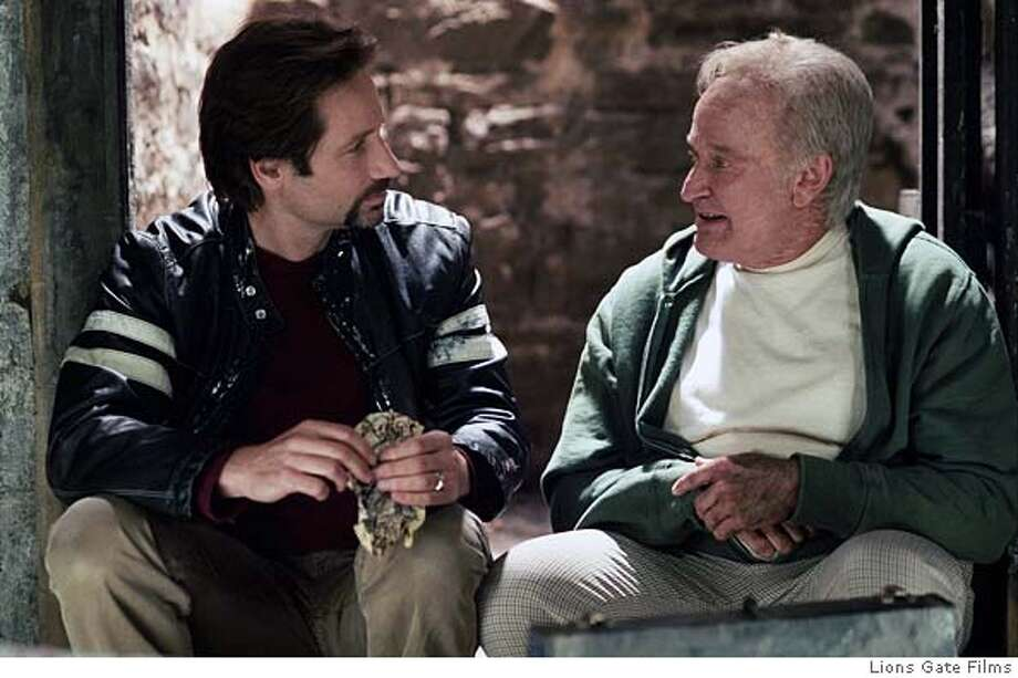 "In this photo provided by Lions Gate Films, Tom Warshaw (David Duchovny) is trying to make sense of his troubled adult life by reflecting upon his extraordinary childhood with his best friend Pappas (Robin Williams), a mentally challenged janitor in ""House of D."" (Lions Gate Films) Ran on: 04-24-2005  David Duchovny and Robin Williams in &quo;House of D,&quo; which Duchovny wrote and directed."