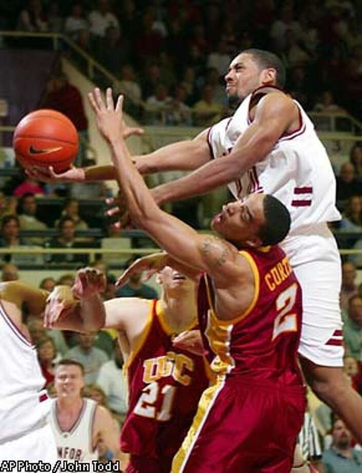 Stanford's Julius Barnes, right, drives past Southern California's Nick Curtis (2) and Rory O'Neil (21) for a basket in the first half in Stanford, Calif., Saturday, Jan. 25, 2003. (AP Photo / John Todd) Photo: JOHN TODD