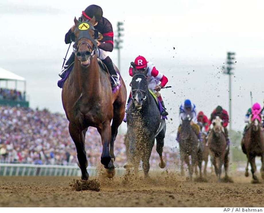 Ghostzapper with jockey Javier Castellano crosses the finish line to win the Breeders' Cup Classic race in Grand Prairie, Texas, Saturday, Oct. 30, 2004. (AP Photo/Al Behrman) Photo: AL BEHRMAN