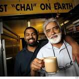 Photo of Raman Belchar (right) and his son, Raj, with a cup of Chai. The real Chai. The drink is all over coffee houses, and new products keep debuting to make it at home, but none compare to the one and only chai at Coastside Gourmet Coffee Tea & Health Nuts in Half Moon Bay. Owner Raman Belchar and his son, Raj, makes the delicious milky sweet Chai that tastes like what you get in India.  Event on 4/11/05 in Half Moon Bay. Craig Lee / The Chronicle