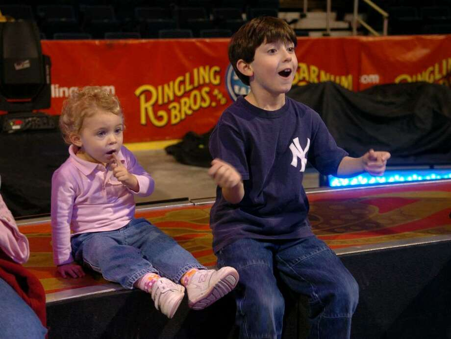 Henry LaGreca, 7, of Stamford, at right reacts as he watches the clowns perform at the Ringling Brothers Barnum and Bailey All Access Pre-Show event at the Arena at Harbor Yard in Bridgeport, Conn. on Thursday Oct. 29, 2009. At left is his sister Alex, 2. Photo: Christian Abraham / Connecticut Post