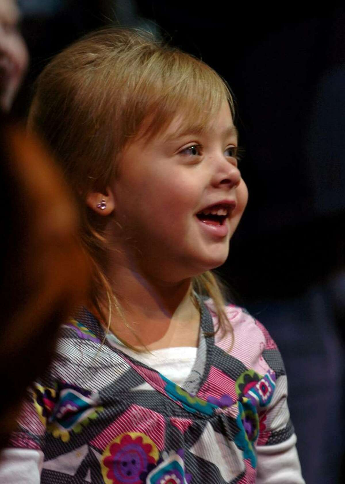 Kayleigh Householder, 4, of Ansonia, laughs as she watches the clowns perform at the Ringling Brothers Barnum and Bailey All Access Pre-Show event at the Arena at Harbor Yard in Bridgeport, Conn. on Thursday Oct. 29, 2009.
