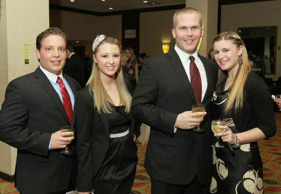 Albany, NY - January 14, 2012 - (Photo by Joe Putrock/Special to the Times Union) - (l to r)Jason Zarillo, Samantha DeJohn, Chris Wessell and Sarah DeJohn during the Third Annual Albany Chef's Food and Wine Festival, Wine & Dine for the Arts, to benefit five Capital District arts organizations. Photo: Joe Putrock / Joe Putrock