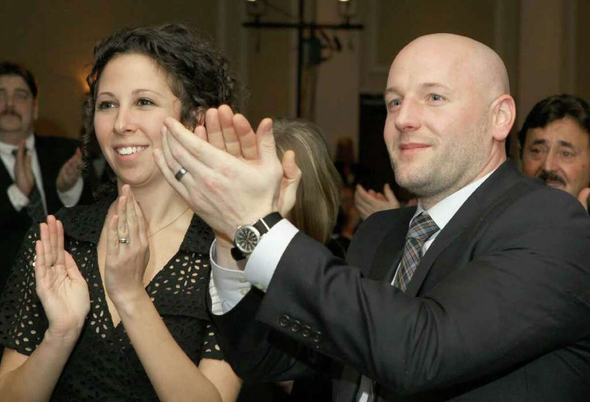 Albany, NY - January 14, 2012 - (Photo by Joe Putrock/Special to the Times Union) - Jen(left) and Jason(right) Wright applaud a performance by a member of Park Playhouse during the Third Annual Albany Chef's Food and Wine Festival, Wine & Dine for the Arts, to benefit five Capital District arts organizations.