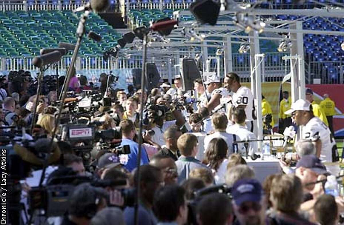 Raiders Jerry Rice, stands above the other Raiders as they answers questions during the Raiders Media Day, Tuesday Jan.21,03, in San Diego.(Left to Right) Gannon, Kennedy, Rice, Garner) SAN FRANCISCO CHRONICLE/LACY ATKINS