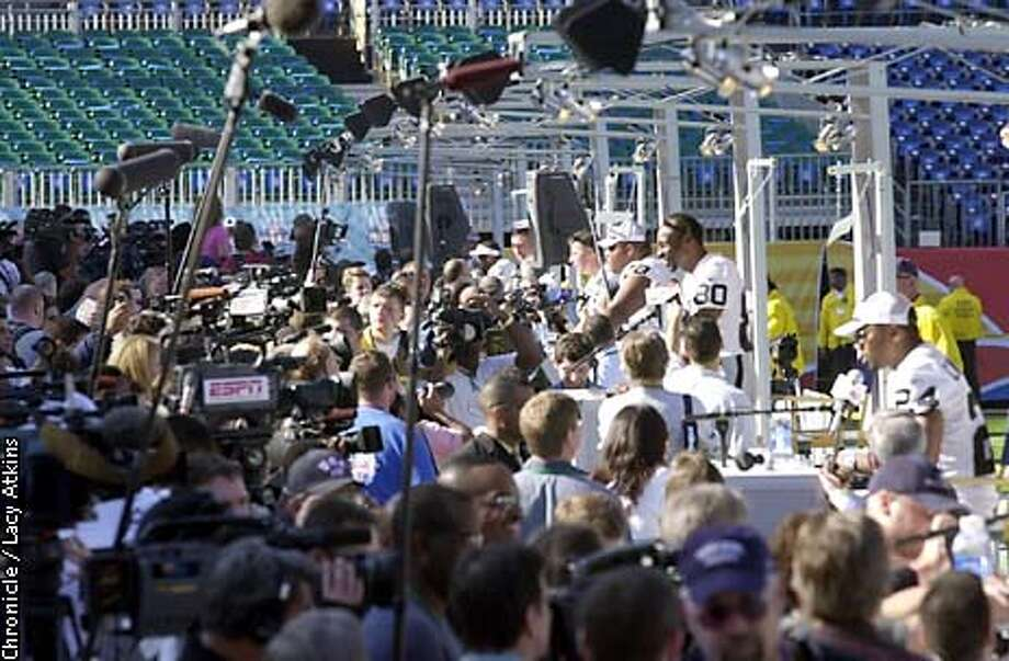 Raiders Jerry Rice, stands above the other Raiders as they answers questions during the Raiders Media Day, Tuesday Jan.21,03, in San Diego.(Left to Right) Gannon, Kennedy, Rice, Garner)  SAN FRANCISCO CHRONICLE/LACY ATKINS Photo: LACY ATKINS