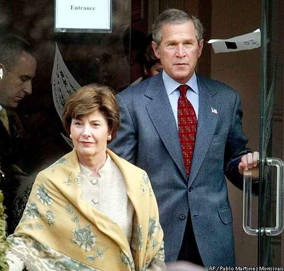 President Bush and first lady Laura Bush walk out of St. John's Episcopal Church after attending Sunday services Sunday, Jan. 26, 2003 in Washington. (AP Photo/Pablo Martinez Monsivais) Photo: PABLO MARTINEZ MONSIVAIS