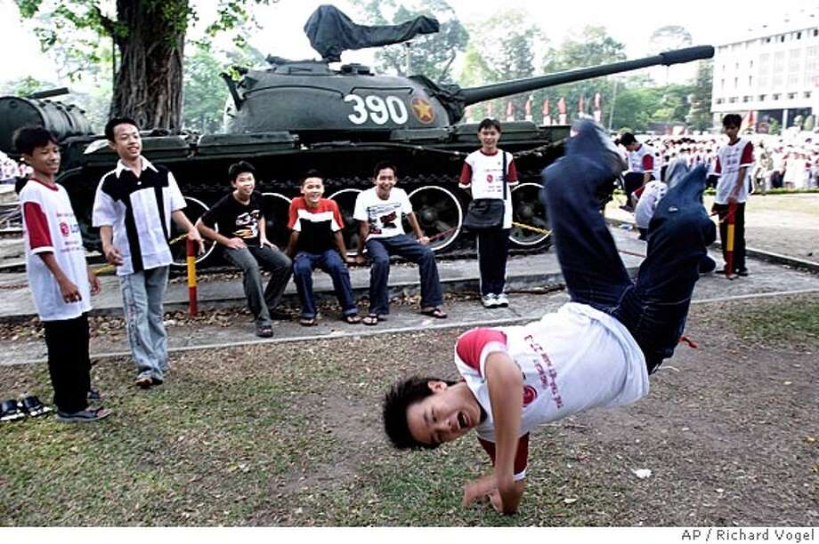 **ADVANCE FOR MONDAY, APRIL 25** Vietnamese teenagers practice breakdancing at the Presidential Palace in Ho Chi Minh City, March 27, 2005. Today's Vietnam is a nation on the move where cell phones have replaced bombs and rock 'n' roll is the new revolutionary music. It is a country of determined youth who have grown up as the first generation in peace. (AP Photo/Richard Vogel) HFR 04-25-05. ADVANCE FOR MONDAY, APRIL 25. Photo: RICHARD VOGEL