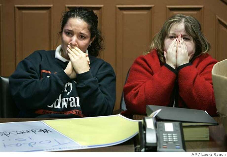 Kerry-Edwards Columbus, Ohio campaign headquarter staffers Jennifer Hart, left, and Bethany Willms react while watching John Kerry concession speech on television on Wednesday, Nov. 3, 2004. (AP Photo/Laura Rauch) Nation#MainNews#Chronicle#11/4/2004#ALL#5star##0422449543 Photo: LAURA RAUCH
