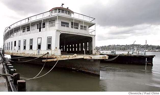 ferryboats_081_pc.jpg  Only the hull remains of the San Leandro (right) which is tied up next to the Fresno (left). Philip Wright visits the aging ferry boat Fresno on 4/23/05 in Vallejo, CA. The Fresno and the San Leandro once plied the waters of the bay ferrying both autos and passengers. Now as they sit anchored and rotting at Mare Island, Wright is hoping to find a buyer to restore the rusty vessels or they will be scrapped after June 1. Wright inherited the boats from his father Arnold Gridley.  PAUL CHINN/The Chronicle MANDATORY CREDIT FOR PHOTOG AND S.F. CHRONICLE/ - MAGS OUT Photo: PAUL CHINN