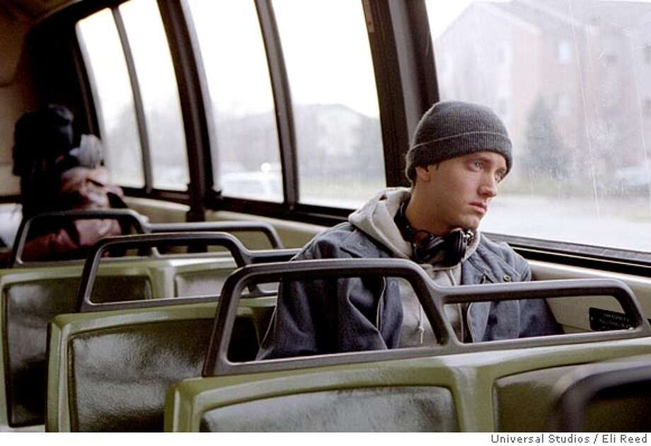 "THIS IS A HANDOUT IMAGE. PLEASE VERIFY RIGHTS. EIGHT08d-C-06NOV02-DD-HO  Jimmy ""Rabbit Smith Jr., played by rapper Eminem, rides the bus to his factory job, in this scene from the movie ""8 Mile."" The rap star makes his big screen debut in the semi-autobiographical film that closely represents a period in the rapper's life growing up in the Detroit area. (Universal Studios, Eli Reed) CAT Photo: ELI REED"