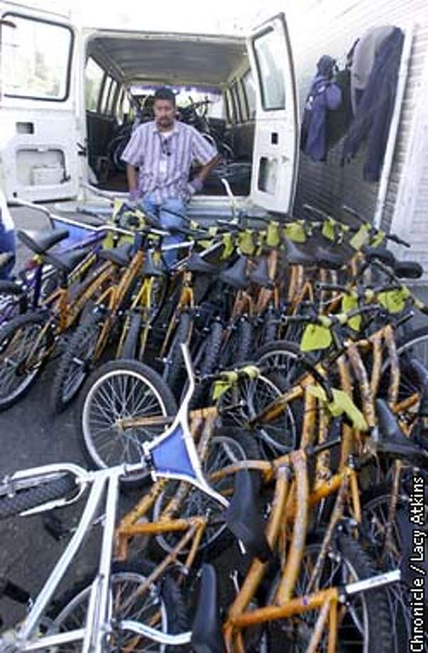 Jaime Malacara, takes a break as he waits for more bikes to be dropped off after they are used by people to get through the US customs faster than those who were on foot, between Tijuana and San Diego.Jaime will gather up the bikes and take them back to Tijuana to be used again.  SAN FRANCISCO CHRONICLE/LACY ATKINS Photo: LACY ATKINS