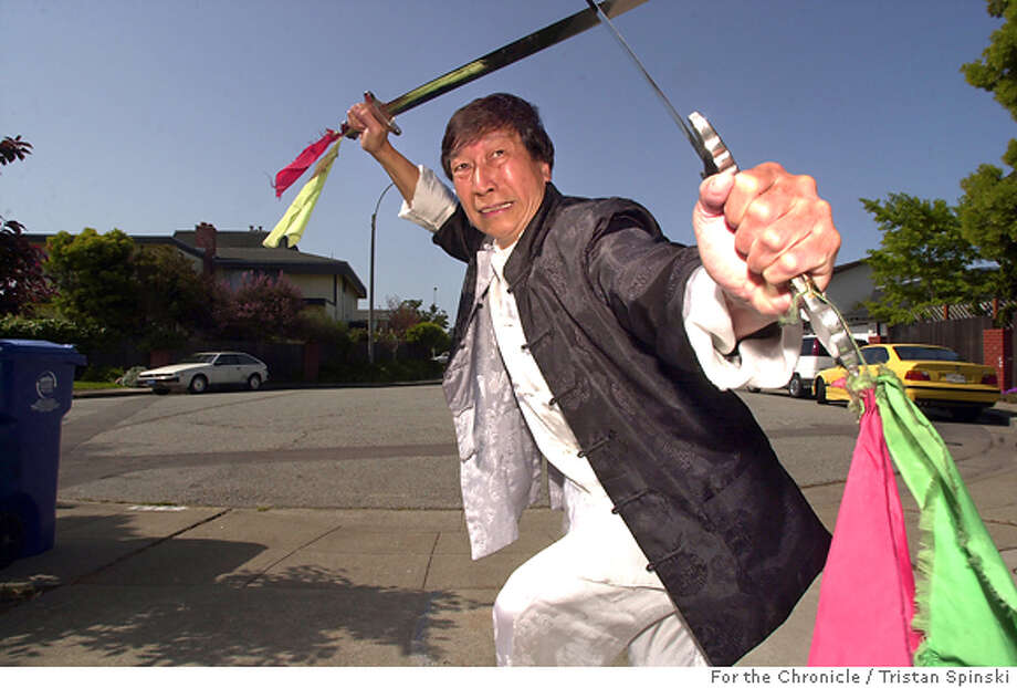Grandmaster Chiu Chi Ling, 62, demonstrates his kung fu swordplay expertise in his driveway in Alameda. The Hong Kong native has lived and taught martial arts in the Bay Area for the past 7 years and stars in Kung Fu Hustle -- due out April 22. Photo: Tristan Spinski