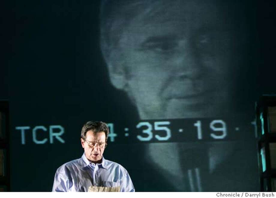 "jonestown22_139_db.jpg  Robert Ernst plays Congressman Leo J. Ryan (photo of the real Ryan is shown in image projected on background), one of several characters at the rehearsal of play ""The People's Temple"" at Berkeley Repertory Theatre.  Event on 4/13/05 in Berkeley.  Darryl Bush / The Chronicle MANDATORY CREDIT FOR PHOTOG AND SF CHRONICLE/ -MAGS OUT Photo: Darryl Bush"