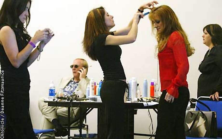 Actress Jane Seymour has her hair done by stylists as her husband, James Keach, talks on his cellphone before the Gridiron Glamour Fashion Show at San Diego Convention Center the day before the Superbowl. Seymour is getting ready to participate in the fashion show.  CHRONICLE PHOTO BY DEANNE FITZMAURICE Photo: Deanne Fitzmaurice
