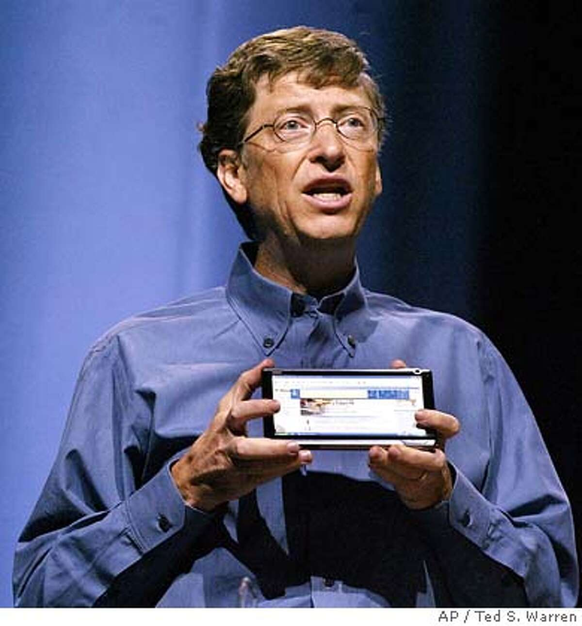 Microsoft Corp. Chairman Bill Gates holds a model of an ultra-mobile concept PC Monday, April 25, 2005 in Seattle that he said was a futuristic example of the use of Windows Operating System technology. Gates delivered the opening keynote address at the 2005 Microsoft Windows Hardware Engineering Conference. (AP Photo/Ted S. Warren)