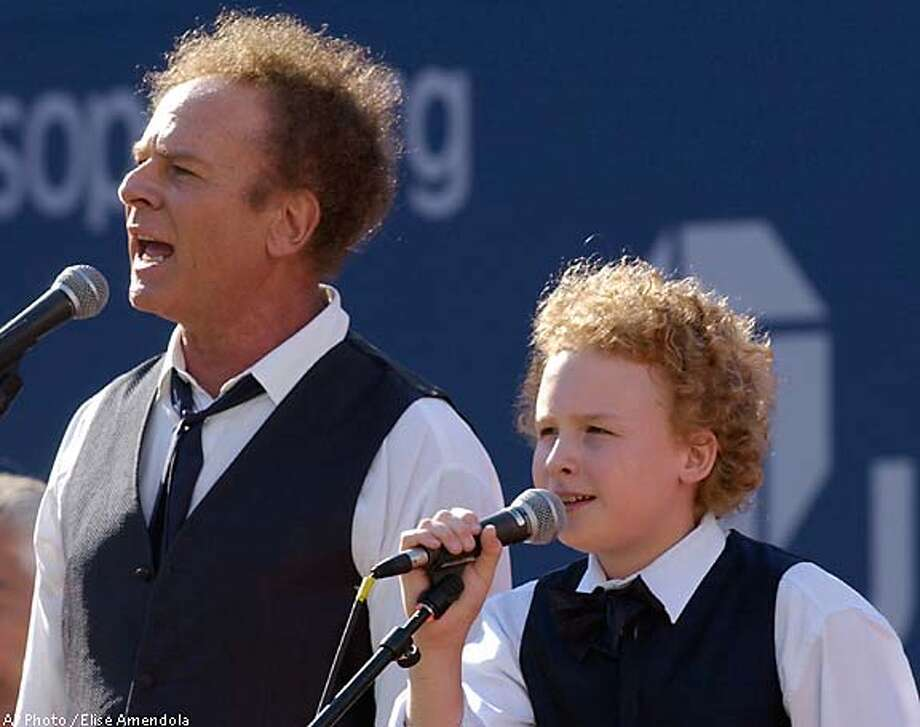 Art Garfunkel and his son, James, sing prior to the men's singles championship at the U.S. Open tennis tournament in New York last year. Associated Press photo by Elise Amendola